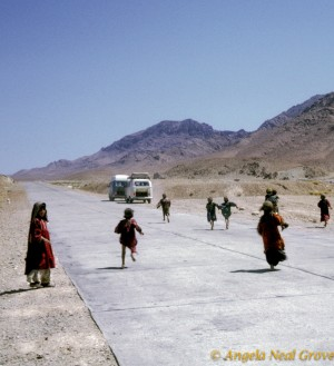 Kochi children running after a van on the Herat-Kandahar Road
