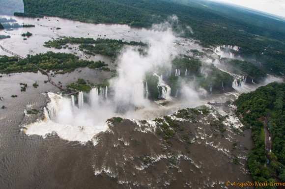 Copter view of Iguazu Falls. Devils Throat on left with viewing walkways over water
