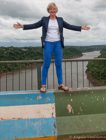Standing on the Friendship Bridge. Argentina on the left and Brazil on the right. the river is the natural border between the two countries