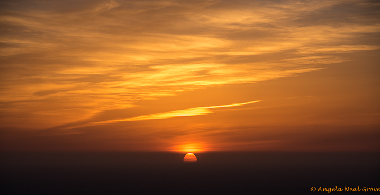 Big Sur Spring Recovery Update; Sunset over Pacific Ocean from Big Sur after a winter of devastating floods and mudslides://Photo: Angela Neal Grove