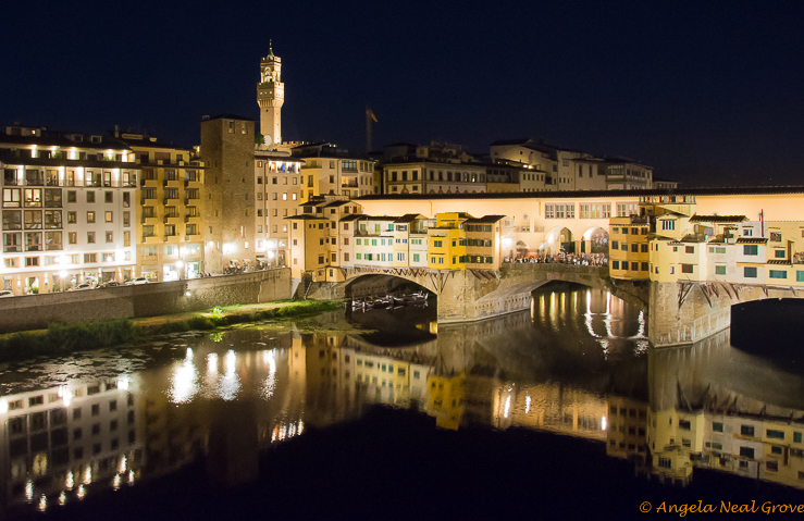 Florence Highlights and Tuscan Tales: The Ponte Vecchio bridge over the River Arno at night