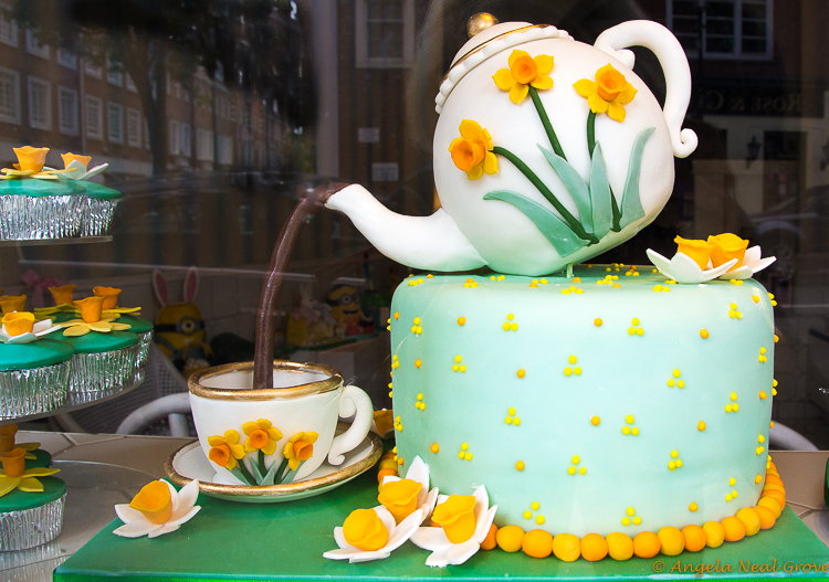 "London Update News and Views; cake in shape of a teapot and cup. The ""tea"" is chocolate"