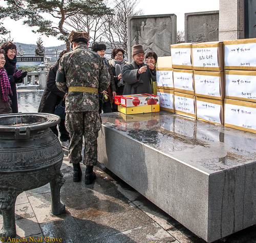 Korea's DMZ through my lens: Buddhist Monk blessing care packages of fruit and warm clothing at the DMZ Peace Temple