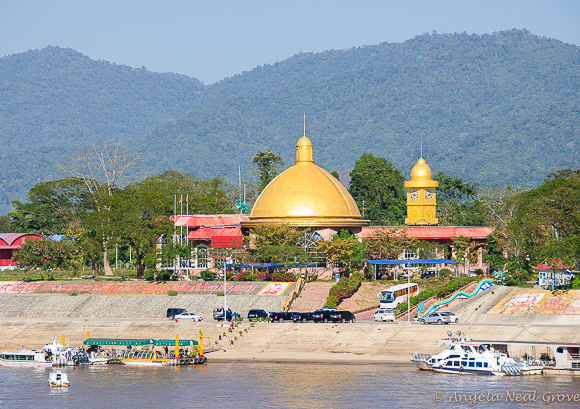 Closeup of casino in Laos with the boats and buses that take guests from the Mekong River to the Casino | Photo: Angela Neal Grove