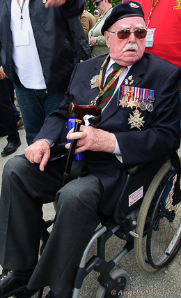 Photo of Veteran with his medals in a wheelchair attending the 70th Anniversary of D-Day | Photo: Angela Neal Grove