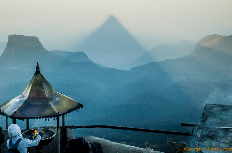 Climbing Adams Peak in Sri Lanka: At sunrise there is the shadow of the mountain which hangs suspended over the valley below