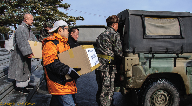 Korea's DMZ Through My Lens: Peacekeepers loading care packages which will be driven across the border to families in North Korea. No one is sure they will reach their destination