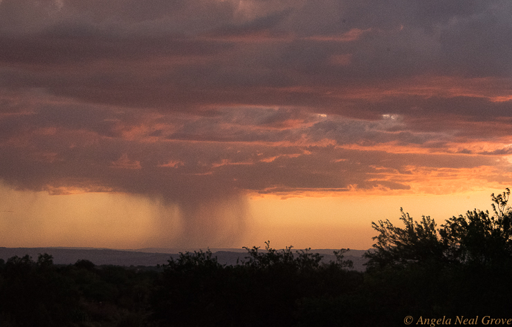 Otherworldly Atacama Desert. A rainstorm during a stormy sunset seen from the roof of the Explora Lodge. PHOTO: AN GROVE