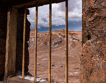 Otherworldly Atacama Desert. Looking out through the window of a deserted mining ghost camp near the Valley of Mars. PHOTO; AN GROVE