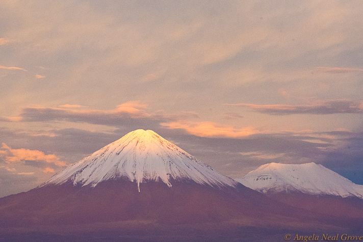 Otherworldly Atacama Desert. Licancabur Volcano seen during a stormy sunset from the Explora Lodge roof terrace. The snowy white carapace is rare as there is usually not enough precipitation to create thick snow. Licancabur is a favorite volano to climb. PHOTO: AN GROVE