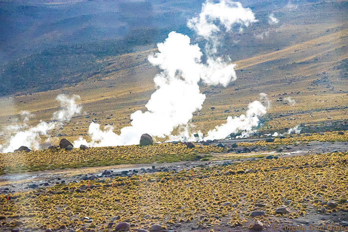 El Tatio Geyser Field, the third largest in the world. Here clouds of steam rises in the early morning. The steam and geysers are created when underground water meets underground rocks heated by volcanoes.