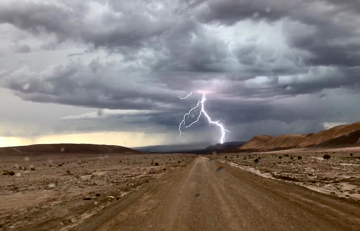 Otherworldly Atacama Desert. On the way back from hiking the Rio Blanco trail we could see a storm was coming in. The lightening show was spectacular. Explora Lodge called to make sure we were safe and as a precaution we took the antenna off our truck and put it inside. This image was taken by our guide.